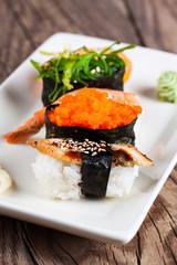 fresh sushi on wooden background