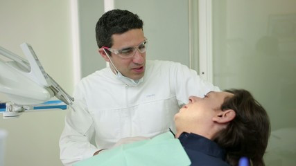 Dentist visiting patient in dental studio