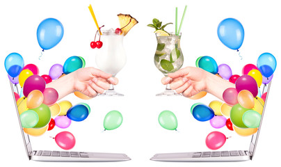 hand with cocktailand laptop