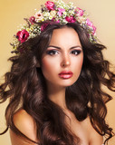 Young Beauty with Wreath of Flowers. Perfect Brown Hairs. Luxury