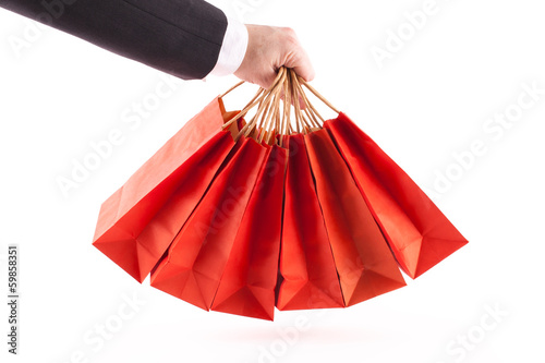 Man holding red shopping bags on white background