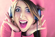 Happy shocked woman in pink listening to good music