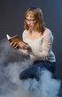 The young woman reads the old book