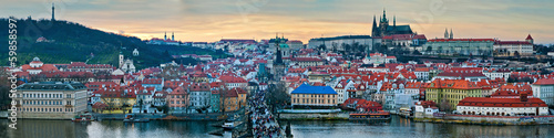 Panoramic winter view of Prague on the sunset