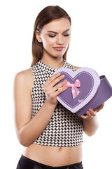 disappointed beautiful girl holding gift box on white background