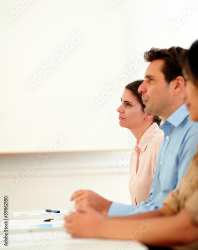 Business people listen during a meeting