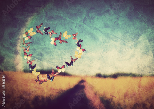 Foto op Canvas Weide, Moeras Heart shape made of butterflies on vintage field background
