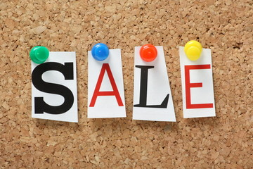 The word Sale on a cork notice board