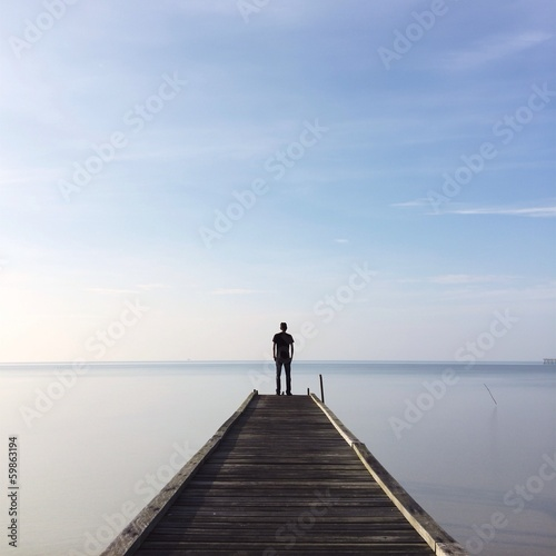 people standing on jetty