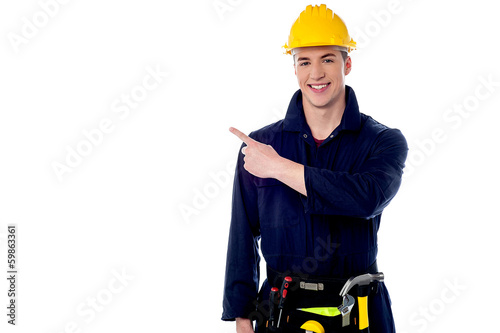 Construction worker pointing away
