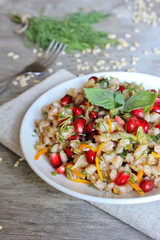 Pearl barley warm salad with carrot, onion and pomegranate