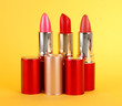 Lipsticks on yellow background