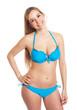 Stehende Frau im blauen Bikini