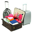 Suitcases with clothes isolated on white