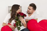Happy loving couple with red rose