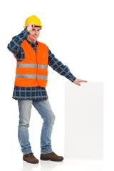Construction worker holding bar chart.