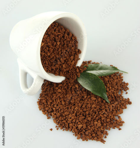 Cup with instant coffee isolated on white