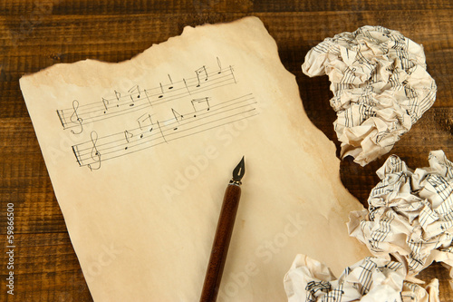 Crumpled paper balls with ink pen and music sheet