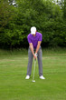 Golfer playing a mid iron shot
