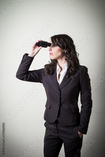 beautiful young businesswoman with binocular