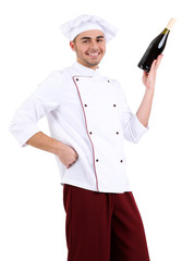 Professional chef in white uniform and hat,holding bottle of