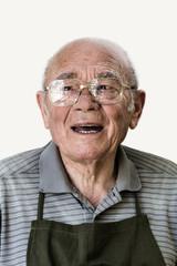 Portrait of senior man against white background