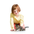 smiling kid girl playing with cat kitten