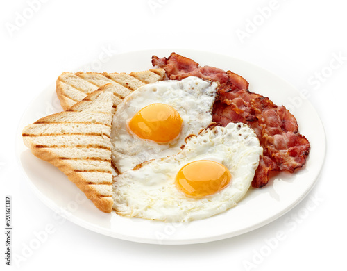 Keuken foto achterwand Egg Breakfast with fried eggs, bacon and toasts