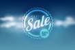 Sale seal on blue sky