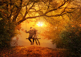 Fototapety Romantic couple swing in the autumn park