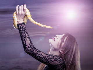 Woman holds in her hand the snake