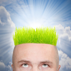 A man with hairstyle from green grass. Innovation concept.