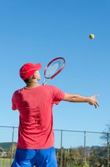 tennis player serve the ball
