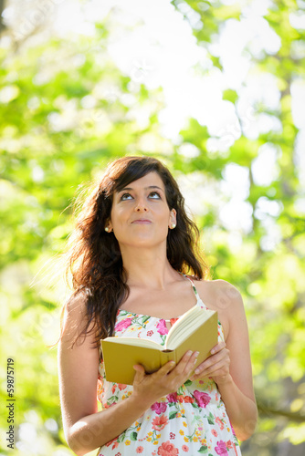 Woman reading and having idea