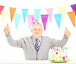Middle aged man celebrating his birthday giving thumbs up