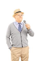 Happy senior man holding a microphone