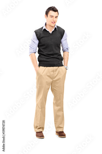 Guy standing with hands in his pockets