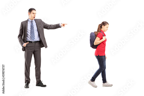 Full length portrait of angry father yelling at his daughter