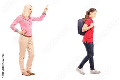 Full length portrait of angry mother yelling at her daughter