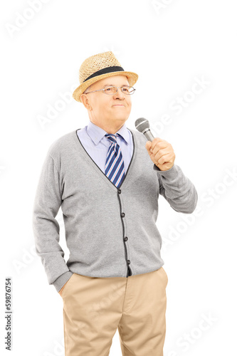 Happy senior man holding a microphone