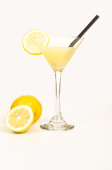 cocktail of lemon juice and vodka in a tall glass