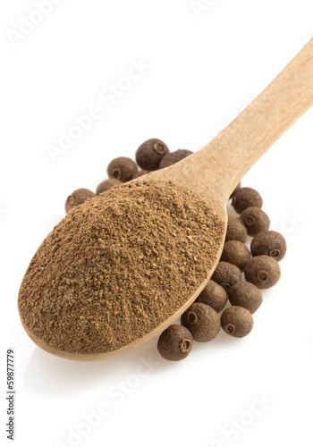 allspice powder and wooden spoon