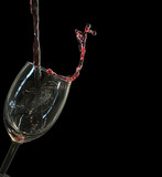 Red wine splashing from glass