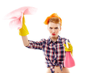 Unhappy housewife holding spray and piece of cloth
