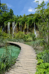 Waterfall and Wooden Path in Plitvice National Park in Croatia