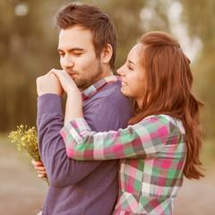 guy kisses the girl's hand