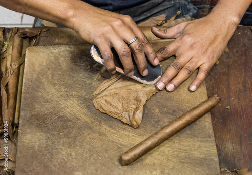 Man preparing cuban cigars