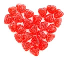 Valentines Day heart of red gummy candies over white