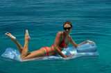 Woman in red bikini on floating device