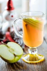 Fresh apple juice with  apple slices and cinnamon stick